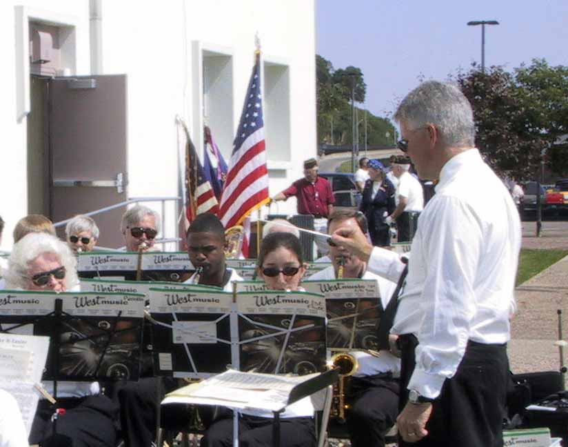 Mark Eveleth conducts the band at the 2003 Memorial Day service