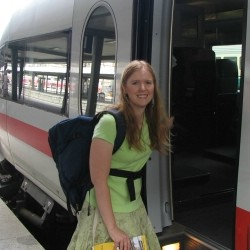 conductor Carmen Lachnitt boards a train in Europe