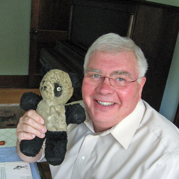 conductor Jim Priebe with Teddy